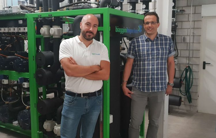 Luca Rossi and Andrea Skori with the compressor rack at the Riazzino store.