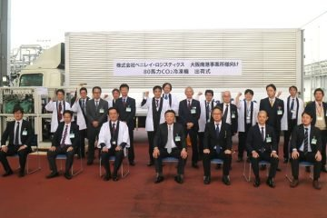 Executives and team members from Panasonic, Benirei Logistics, Nichirei Logistics and Sanrei Corp. pose during an official shipment ceremony held at Panasonic's factory in Gunma prefecture on October 16.