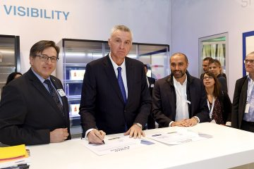 Davin Moon, President of Carrier Commercial Refrigeration, signing the Iceman Agreement, flanked by Felix Reiterits, International Key Account Manager at Carrier (left) and Asad Omar, Global Director Investment & Technical Solutions at Metro AG (right).